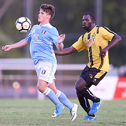 BRISBANE, AUSTRALIA - JANUARY 27: Rhys Raymond of City controls the ball under pressure from Sekou Jomanday of the Jets during the Kappa Silver Boot Third Place match between Moreton Bay United and Brisbane City on January 27, 2018 in Brisbane, Australia. (Photo by Patrick Kearney)