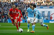 David Silva of Manchester City looks to go past Jordan Henderson of Liverpool. Capital One Cup Final, Liverpool v Manchester City at Wembley stadium in London, England on Sunday 28th Feb 2016. pic by Chris Stading, Andrew Orchard sports photography.