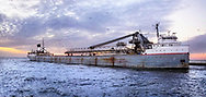 A Great Lakes Freighter Heading Out To Sea At Sundown, Grand Haven Michigan