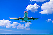 An American Airlines jet on final approach into St. Maarten's Princess Juliana International Airport. <br />