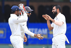 August 5, 2017 - Colombo, Sri Lanka - Indian cricketer Mohammed Shami (R) is congratulated by Indian players during the 3rd Day's play in the 2nd Test match between Sri Lanka and India at the SSC international cricket stadium at the capital city of Colombo, Sri Lanka on Saturday 5th August 2017. (Credit Image: © Tharaka Basnayaka/NurPhoto via ZUMA Press)