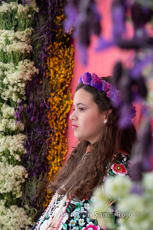 Madrid, Spain. 6th May, 2018. Portrait of the 'Maya' Andrea wearing a flower tiara made of different types of violets, sitting on her altar sourrounded by lavender, thyme and other wild flowers. © Valentin Sama-Rojo.
