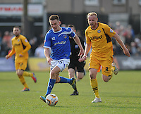 Portsmouth's Jed Wallace vies for possession with Newport County's Lee Minshull<br /> <br /> Photo by Ashley Crowden/CameraSport<br /> <br /> Football - The Football League Sky Bet League Two - Newport County AFC v Portsmouth - Saturday 29th March 2014 - Rodney Parade - Newport<br /> <br /> © CameraSport - 43 Linden Ave. Countesthorpe. Leicester. England. LE8 5PG - Tel: +44 (0) 116 277 4147 - admin@camerasport.com - www.camerasport.com