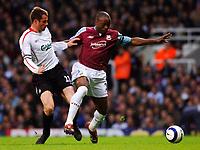 Photo: Daniel Hambury.<br />West Ham United v Liverpool. The Barclays Premiership. 26/04/2006.<br />West Ham's Nigel Reo-Coker and Liverpool's Jamie Carragher battle.