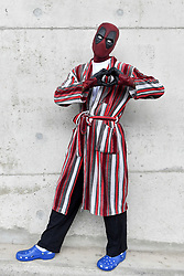 © Licensed to London News Pictures. 25/05/2018. LONDON, UK.  A cosplayer as Deadpool attends MCM Comic Con at Excel in East London.   Thousands of fans of video games, comic books and other popular character take the opportunity to dress up as their favourite characters.  Photo credit: Stephen Chung/LNP