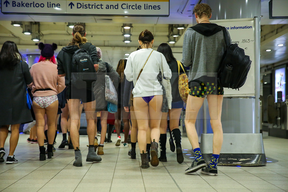 """© Licensed to London News Pictures. 13/01/2019. London, UK. Participants take part in 10th anniversary of 'No Trousers Tube Ride' event by travelling on the District Line on the London underground. The """"No Pants Subway Ride"""" is an annual event staged by Improve Everywhere every January in New York City. The mission started as a small prank with seven guys and has grown into an international celebration of silliness, with dozens of cities including London around the world participating each year. Photo credit: Dinendra Haria/LNP"""