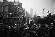 The remains of Roger Casement, Irish Patriot, were removed from the Military Church, Arbour Hill, where they lay in state for 4 days, to the Pro-Cathedral. Onlookers watch as the funeral procession passes the O'Connell monument..18.02.1965 Photos, Photo, Snap, Streets, Street,