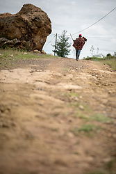 3 March 2017, Thaba Bosiu, Lesotho: Soko Mjanakheti is on his way to the clinic, in the village of Thaba Bosiu, Lesotho. Thaba Bosiu is a sandstone plateau some 24 kilometers east of Lesotho's capital, Maseru. The name means Night Mountain, and surrounding the plateau is a small village and open plains. Thaba Bosiu was once the capital of Lesotho, and the mountain was the stronghold of the Basotho king when the kingdom of Lesotho was formed.