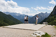 Visitors admire mountain views at the top of Vrsic Pass in the Slovenian Julian Alps, on 22nd June 2018, in Triglav National Park, Slovenia.