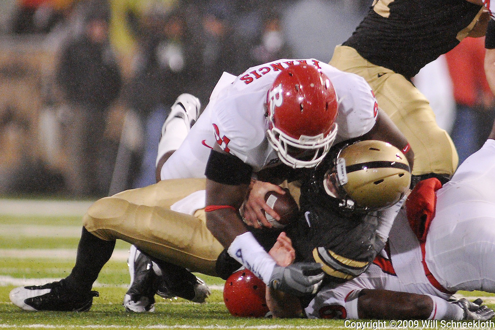 Oct 23, 2009; West Point, N.Y., USA; Rutgers defensive tackle Justin Francis (91) sacks Army quarterback Trent Steelman (8) during Rutgers' 27 - 10 victory over Army at Michie Stadium.