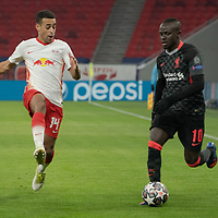 Tyler Adams (L) of RB Leipzig and Sadio Mane (R) of Liverpool FC fight for the ball during the UEFA Champions League Round of 16 First Leg Football match between RB Leipzig and Liverpool FC in Budapest, Hungary on Feb. 16, 2021. ATTILA VOLGYI