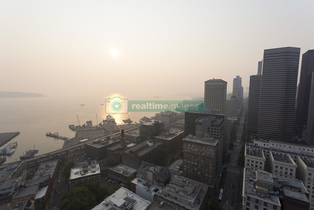 August 3, 2017 - Seattle, Washington, U.S. - The Port of Seattle is obscured as wildfires in Canada cloak downtown Seattle in thick haze and smoke. The reduced air quality coupled with soaring temperatures has caused an unhealthy air quality rating in the region. (Credit Image: © Paul Gordon via ZUMA Wire)