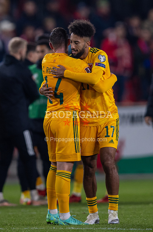 PRAGUE, CZECH REPUBLIC - Friday, October 8, 2021: Wales' Sorba Thomas (R) embraces Connor Roberts after the FIFA World Cup Qatar 2022 Qualifying Group E match between Czech Republic and Wales at the Sinobo Stadium. The game ended in a 2-2 draw. (Pic by David Rawcliffe/Propaganda)