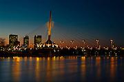 Esplanade Riel bridge and city skyline reflected in teh Red River at dusk<br /> Winnipeg<br /> Manitoba<br /> Canada
