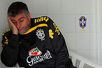 20090604: TERESOPOLIS, BRAZIL - Brazil National Team preparing match against Uruguay. In picture: Brazil's doctor Jose Luiz Runco sleeping during the training session. PHOTO: CITYFILES