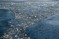 A trail of broken ice in the wake of the ferry between Toronto and Wards Island aproaching the spring season.
