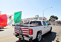 """Flags were everywhere for Sunday's """"El Grito"""" celebration in Salinas marking the anniversary on September 16th of Mexico's independence from Spain. The annual fiesta, which occupies East Alisal Street between Wood and Sanborn, brimmed as usual with booths selling patriotic souvenirs and all manner of food and drink. Local businesses and nonprofits manned booths with information about health and community programs, while traditional """"bandas"""" filled the afternoon with dance music and good cheer."""
