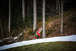 09.01.2014, Biathlonarena, Ruhpolding, GER, E. ON IBU Weltcup, Staffel, Herren, im Bild ein Teilnehmer auf einem weissen Schneeband in einem schneefreien Wald // a competitor on the small snow-track in the snow-free forest during Mens Relay of E. ON IBU Biathlon World Cup at the Biathlonstadium in Ruhpolding, Germany on 2014/01/09. EXPA Pictures © 2014, PhotoCredit: EXPA/ Martin Huber