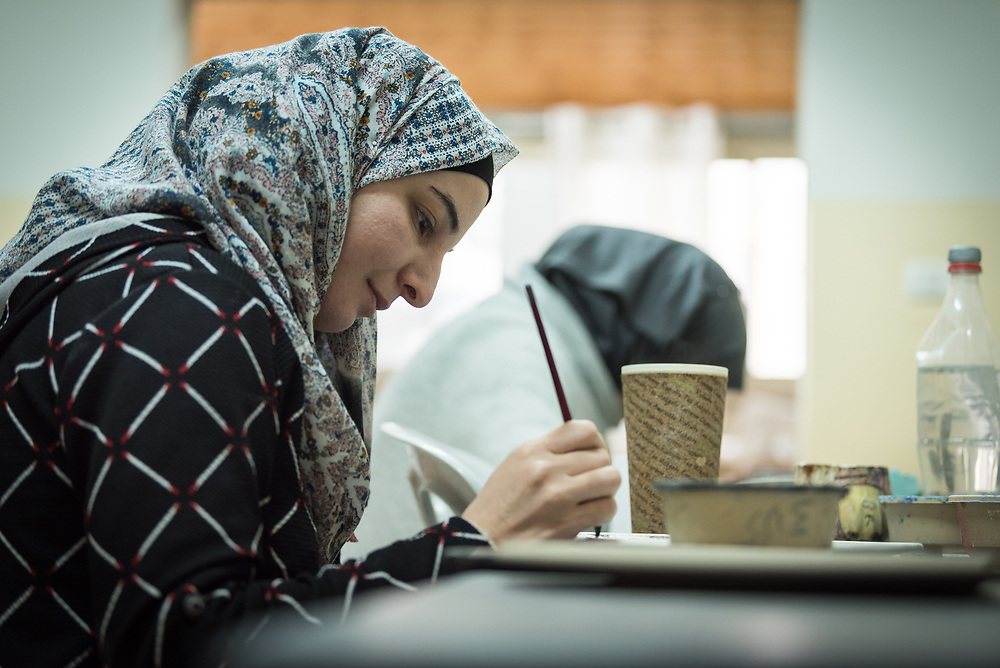 25 February 2020, Jerusalem: Student Asma Ashmar works on a design in ceramics class. The Lutheran World Federation's vocational training centre in Beit Hanina offers vocational training for Palestinian youth across a range of different professions, providing them with the tools needed to improve their chances of finding work.