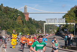 © Licensed to London News Pictures. 15/09/2019. Bristol, UK. Runners in the Bristol Half Marathon approach the Avon Gorge and the Clifton Suspension Bridge in unseasonably warm September weather. Photo credit: Simon Chapman/LNP.