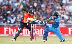 India's Lokesh Rahul hit for 4 past England's wicket keeper Jos Buttler, during the 1st Vitality IT20 Series match at Emirates Old Trafford, Manchester.