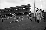 06/09/1964<br /> 09/06/1964<br /> 6 September 1964<br /> All-Ireland Senior Final: Tipperary v Kilkenny at Croke Park, Dublin.<br /> Martin Coogan goes down with a bad head injury as goalie, O. Walsh races from his net to stop a Tipperary ball.