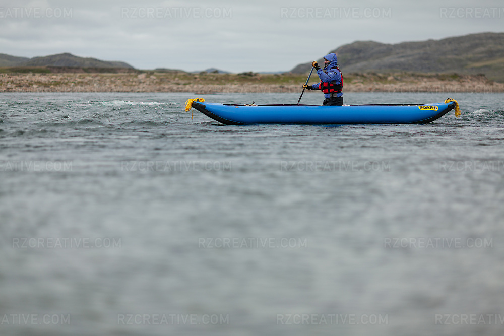 Paddler on the Sylvia Grinnell River in Iqaluit, NU, Canada. Photo © Robert Zaleski / rzcreative.com<br /> —<br /> To license this image for editorial or commercial use, please contact Robert@rzcreative.com