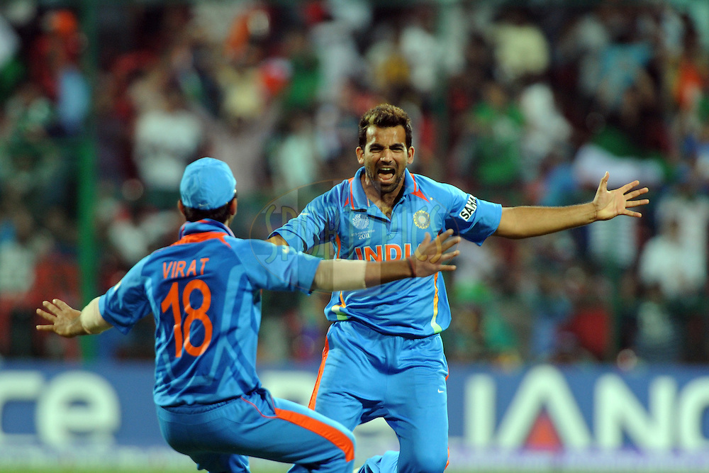 Zaheer Khan of India celebrate the wicket of Ian Bell of England during the ICC Cricket World Cup match between India and England held at the M Chinnaswamy Stadium in Bengaluru, Bangalore, Karnataka, India on the 27th February 2011..Photo by Pal Pillai/BCCI/SPORTZPICS