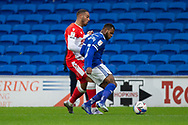 Millwall's Kenneth Zohore (13) is tackled by Cardiff City's Leandro Bacuna (7) during the EFL Sky Bet Championship match between Cardiff City and Millwall at the Cardiff City Stadium, Cardiff, Wales on 30 January 2021.