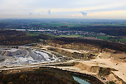 Nederland, Limburg, Maastricht, 07-03-2010; Sint-Pietersberg, mergelgroeve voor de winning van mergel (eigenlijk kalksteen) in dagbouw door cementfabriek ENCI.  Wat er nog resteert van de St.Pietersberg, rond de greeve, is beschermd natuurgebied en bovengronds en ondergronds aangewezen als beschermd Habitatrichtlijngebied. Marl quarry for the extraction of marl (limestone actually) in surface mining by cement factory ENCI. Maastricht at the horizon. What is left of the Sint-Pietersberg is designated as protected area, both on groundlevel and underground the habitat directives apply.  luchtfoto (toeslag), aerial photo (additional fee required); foto/photo Siebe Swart