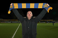 AFC Wimbledon fan holding up scarf during the EFL Sky Bet League 1 match between AFC Wimbledon and Burton Albion at the Cherry Red Records Stadium, Kingston, England on 28 January 2020.