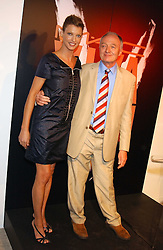 Model LINDA EVANGELISTA and KEN LIVINGSTON at a cocktail party hosted by MAC cosmetics to kick off London Fashion Week at The Hospital, 22 Endell Street London on 18th September 2005.At the event, top model Linda Evangelista presented Ken Livingston the Lord Mayor of London with a cheque for £100,000 in aid of the Loomba Trust that aims to privide education to orphaned children through a natural disaster or through HIV/AIDS.<br /><br />NON EXCLUSIVE - WORLD RIGHTS