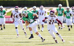 Sep 5, 2020; Huntington, West Virginia, USA; Marshall Thundering Herd tight end Garet Morrell (12) makes a catch and makes a move around Eastern Kentucky Colonels defensive back Daulson Fitzpatrick (27) during the first quarter at Joan C. Edwards Stadium. Mandatory Credit: Ben Queen-USA TODAY Sports