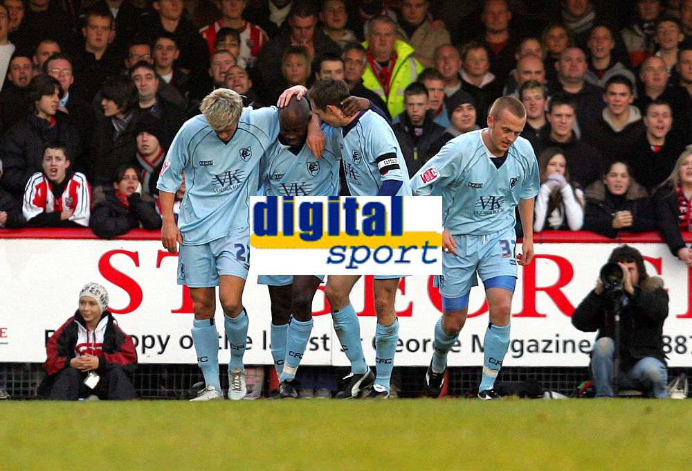 Photo: Frances Leader.<br />Brentford v Chesterfield. Coca Cola League 1. <br />10/12/2005.<br />Chesterfield's Paul Hall (C) celebrates his goal of the first half.
