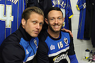Dannie Bulman midfielder of AFC Wimbledon (4) and Rhys Murphy forward for AFC Wimbledon (39) face their old clubs prior the Sky Bet League 2 match between AFC Wimbledon and Crawley Town at the Cherry Red Records Stadium, Kingston, England on 16 April 2016. Photo by Stuart Butcher.