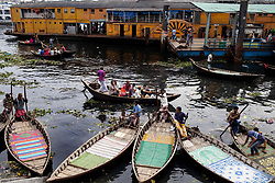 June 4, 2017 - Dhaka, Dhaka, Bangladesh - June 04, 2017 Dhaka, Bangladesh - Boatmen waiting for passenger beside the Burigonga River on the day before of World Environment Day. A large swathe of the Buriganga River, which is the lifeline of the capital, has turned pitch-black with toxic waste, oil and chemicals flowing into it from industrial units. The water became extremely polluted and represents a health hazard for the riverbed communities. (Credit Image: © K M Asad via ZUMA Wire)