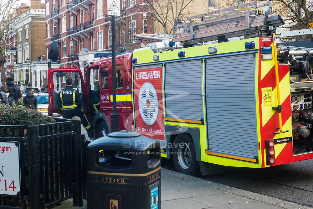 Firefighters are still on the scene at Holland Park Gardens after a fire in a flat on the first floor of a converted house claims the life of a man and his dog in Holland Park, West London. February 07 2018.