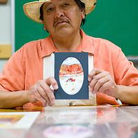 030613       Brian Leddy<br /> Navajo artist Gilbert Jumbo's paintings will display at Sammy C's Rockin Sports Pub at this month's ArtsCrawl.