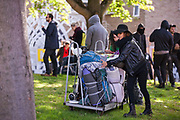 Housing activists remove their possessions after having been evicted by bailiffs from the Sweets Way housing estate on 23rd September 2015 in London, United Kingdom. A group of housing activists calling for better social housing provision in London had occupied some of the properties on the 142-home estate in Whetstone, in some cases refurbishing properties intentionally destroyed by the legal owners following eviction of the original residents, in order to try to prevent the eviction of the last resident on the estate and the planned demolition and redevelopment of the entire estate by Barnet Council and Annington Property Ltd.