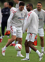 Photo: Paul Thomas.<br /> England training at Carrington. 30/08/2006. <br /> <br /> Wayne Bridge and Ashley Cole (R).