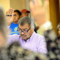 101614       Adron Gardner/Independent<br /> <br /> Michael Coan votes with fellow Navajo Nation Board of Election Supervisors for an executive session in Window Rock Thursday.