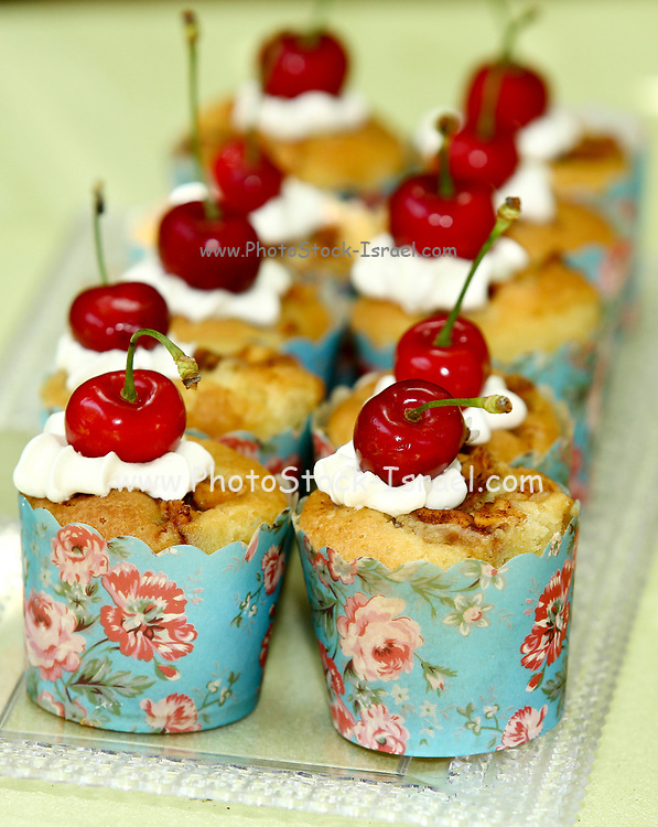 cupcakes with cherries and whipped cream This image has a restriction for licensing in Israel