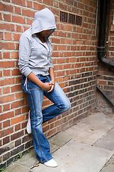Teenager hanging around on the street,