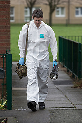 © Licensed to London News Pictures . 19/12/2013 . Manchester , UK . Police and a Royal Logistic Corps Bomb Disposal team at a flat on Colebrook Drive , Moston , Greater Manchester this afternoon (19th December 2013) after police found a suspicious device and what they believe to be ammunition at a flat , following a raid  . Photo credit : Joel Goodman/LNP