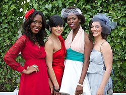 LIVERPOOL, ENGLAND - Friday, April 4, 2014: Tobi Adetunji, Jag Sahota, Dayo Adetunji and Paloma Fernandez during Ladies' Day on Day Two of the Aintree Grand National Festival at Aintree Racecourse. (Pic by David Rawcliffe/Propaganda)