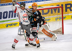 21.02.2021, Keine Sorgen Eisarena, Linz, AUT, EBEL, EHC Liwest Black Wings Linz vs iClinic Bratislava Capitals, 48. Qualifikationsrunde, im Bild v.l. Filip Ahl (iClinic Bratislava Capitals), Oskars Bartulis (Steinbach Black Wings 1992) // during the bet-at-home ICE Hockey League 48th qualifying round match between EHC Liwest Black Wings Linz and iClinic Bratislava Capitals at the Keine Sorgen Eisarena in Linz, Austria on 2021/02/21. EXPA Pictures © 2021, PhotoCredit: EXPA/ Reinhard Eisenbauer