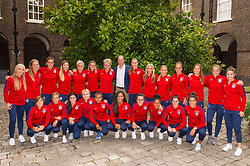 The Duke of Cambridge and members of the England Women football team pose for a group photograph during a reception for the England Women football team at Kensington Palace in London.