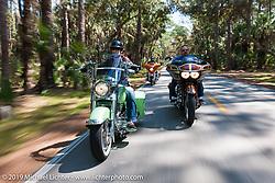 Brian and Laura Klock riding their custom bikes through Tomoka State Park during Daytona Bike Week. FL, USA. March 11, 2014.  Photography ©2014 Michael Lichter.