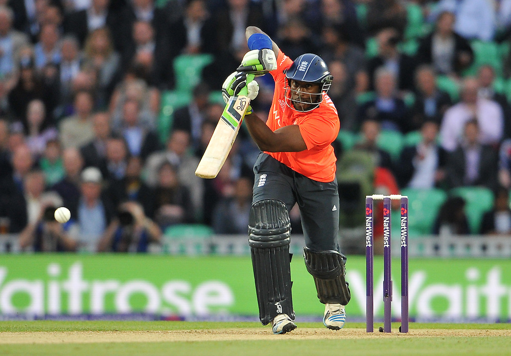 England's Michael Carberry drives during his innings of 7<br /> <br /> Photographer Ashley Western/CameraSport<br /> <br /> International Cricket - 2014 NatWest International T20 - England v Sri Lanka - Tuesday 20th May 2014 - The Kia Oval - London<br /> <br /> © CameraSport - 43 Linden Ave. Countesthorpe. Leicester. England. LE8 5PG - Tel: +44 (0) 116 277 4147 - admin@camerasport.com - www.camerasport.com