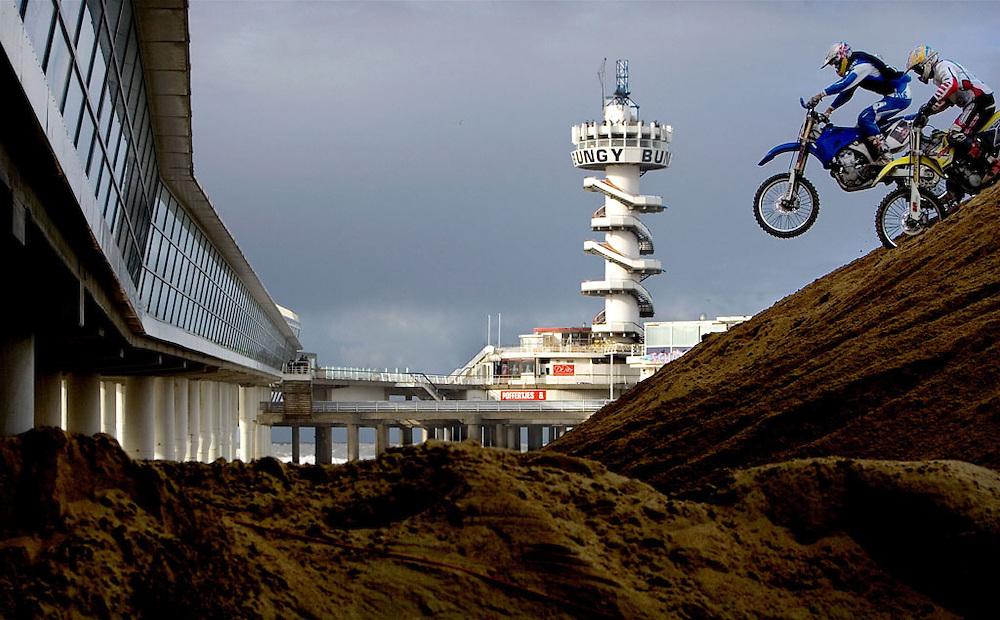The Netherlands, Scheveningen, 12-11-2006.<br /> Motocross on the beach.<br /> Marc de Reuver, a dutch driver, jumps over an opponent with the pier of Scheveningen in the background. De Reuver wins this race.<br /> Photo: Klaas Jan van der Weij